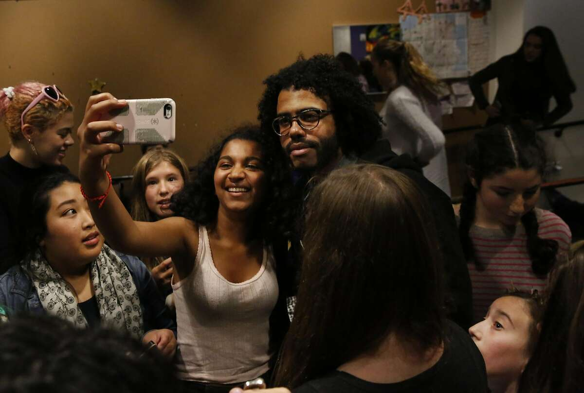 Uma Nagarajan-Swenson, 15, takes a selfie with Hamilton star Daveed Diggs after a question and answer session with him and Poetry Slam alum Chinaka Hodge in the teen center at the Jewish Community Center of San Francisco Sept. 10, 2016 in San Francisco, Calif.