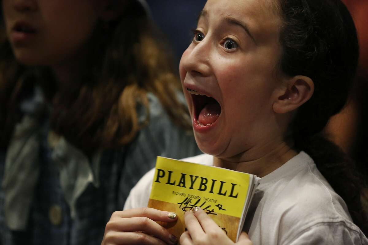 Minna Lezak, 10, can barely contain her excitement while waiting for Hamilton star Daveed Diggs to enter the teen center for a private photo and a question and answer session during a poetry slam-themed evening with him and Poetry Slam alum Chinaka Hodge at the Jewish Community Center of San Francisco Sept. 10, 2016 in San Francisco, Calif.
