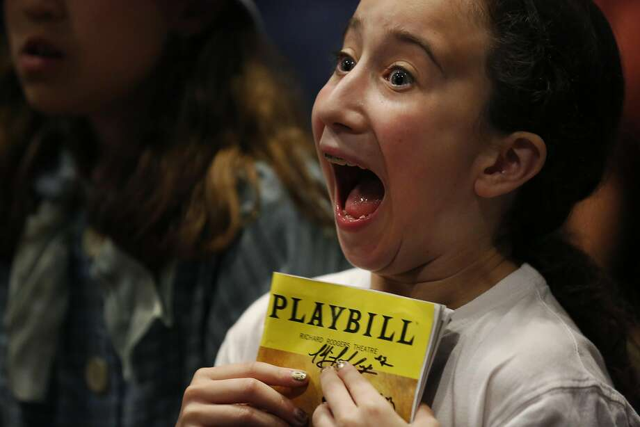 Minna Lezak, 10, can barely contain her excitement while waiting for Daveed Diggs to arrive for a private photo and appearance during a poetry-slam evening. Photo: Leah Millis, The Chronicle