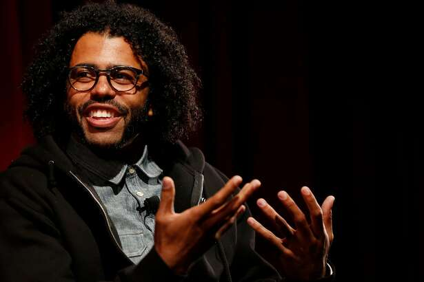 Hamilton star Daveed Diggs answers questions from Poetry Slam alum Chinaka Hodge in front of an audience at the Jewish Community Center of San Francisco Sept. 10, 2016 in San Francisco, Calif.