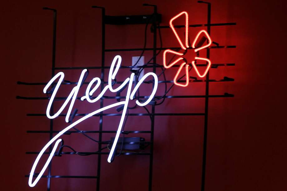 FILE - In this Oct. 26, 2011 file photo, the logo of the online reviews website Yelp is shown in neon on a wall at the company's Manhattan offices in New York. The 9th U.S. Circuit Court of Appeals ruled Monday, Sept. 12, 2016, that online review site Yelp's star rating system does not make it liable for reviews posted on the site. (AP Photo/Kathy Willens, File) Photo: Kathy Willens, Associated Press
