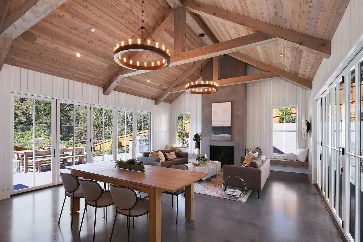 Exposed timber of the great room's open beam, vaulted ceiling complements the home's wooded surroundings.�