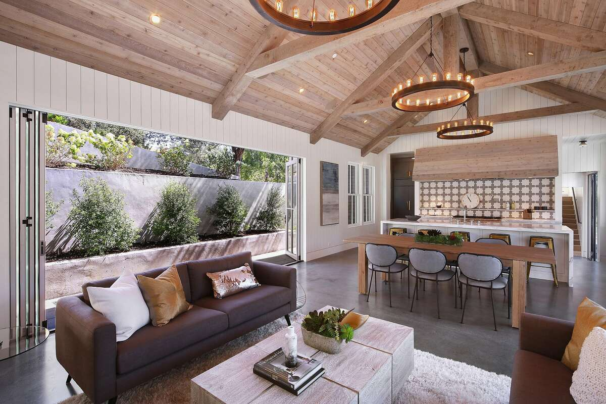 A collapsible NanaWall off the great room opens directly to a Bluestone patio.�