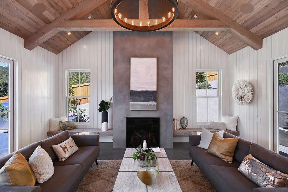Concrete creates the floor and fireplace surround of this contemporary great room at 31 Orange Ave. in Larkspur. Photo: Open Homes Photography