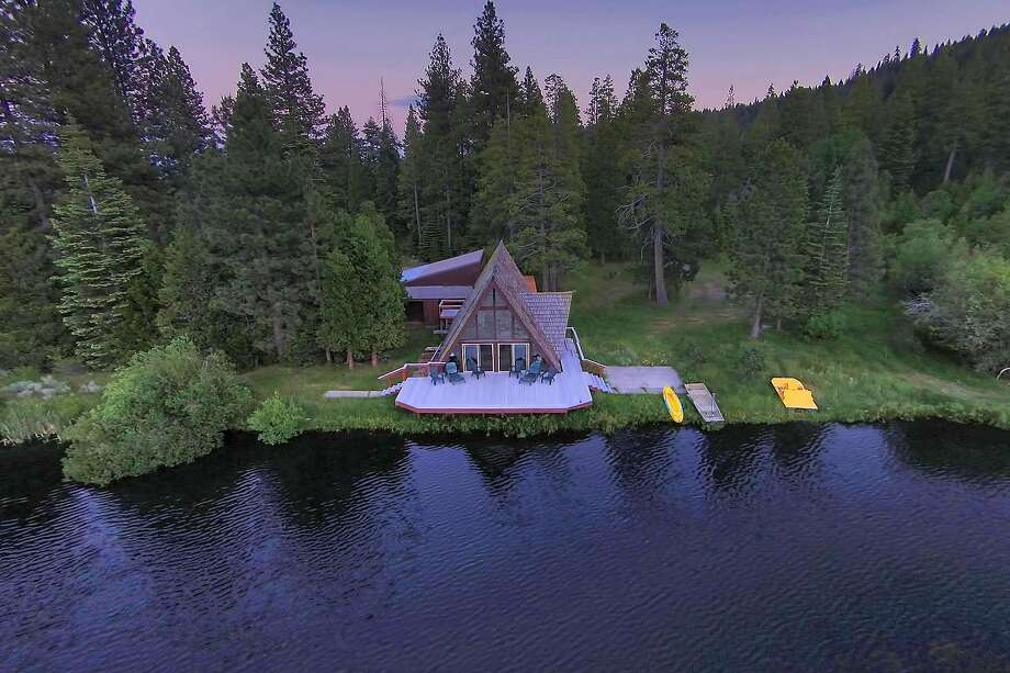 Steep gambrels beget sharply pitched rooftops at this lakeside cabin in Fort Bidwell.  Photo: Peter Tye