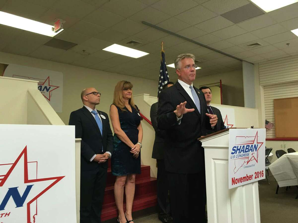 State Rep. John Shaban, of Redding, Republican candidate for Congress in the 4th District, gestures during the opening of his campaign headquarters in Bridgeport Thursday, Sept. 8, 2016. Standing behind him from left to right are state Rep. Jason Perillo, of Shelton; Annalisa Stravato, the state GOP vice chairwoman from Wilton; J.R. Romano (partially obscured), the state GOP chairman and Derby native; and Trumbull First Selectman Tim Herbst.