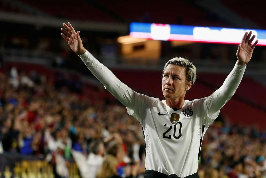U.S. Women's National Team star Abby Wambach salutes the crowd after one of her final games in December. When she looks back on some of those pictures, she says her eyes seem hollow. Photo: Christian Petersen, Getty Images