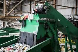 Recycled materials are seen traveling down a mechanical sorting machine at Recology's Recycle Central at Pier 96 in San Francisco, Calif. on Monday, Sept. 12, 2016.