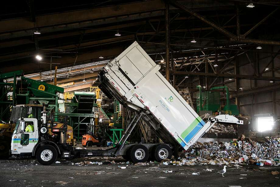 In this file photo, a garbage truck unloads its collection of recyclable materials at Recology's Recycle Central at Pier 96 in San Francisco, Calif. on Monday, Sept. 12, 2016. Photo: Stephen Lam, Special To The Chronicle