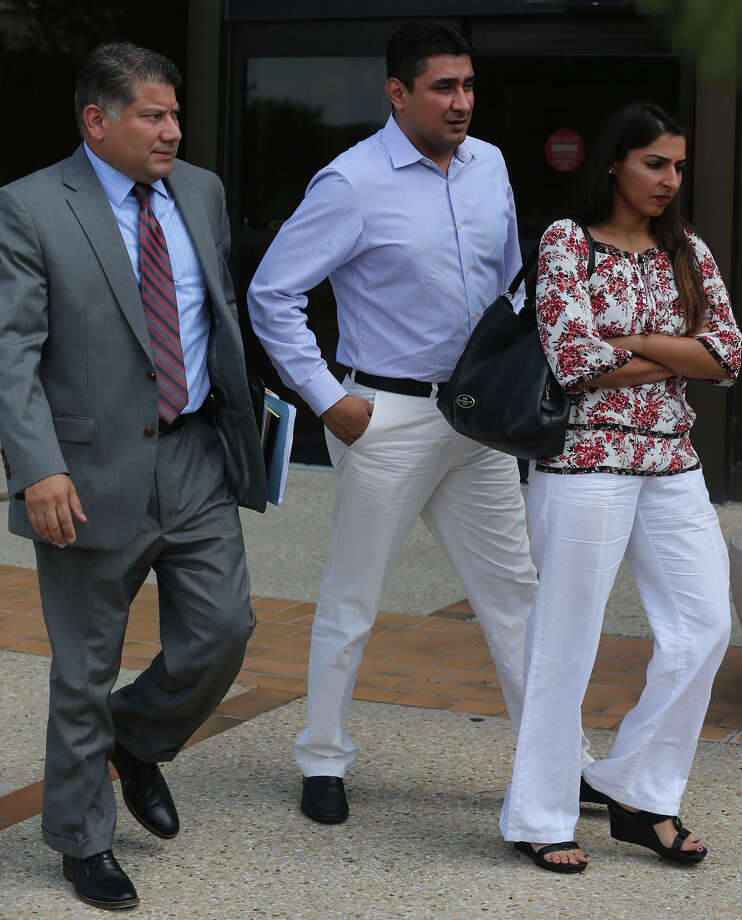 Azeez Mistry (center) leaves the John H. Wood, Jr. Federal Courthouse Monday September 12, 2016. Mistry is facing bribery charges. Photo: John Davenport, Staff / San Antonio Express-News / ©San Antonio Express-News/John Davenport