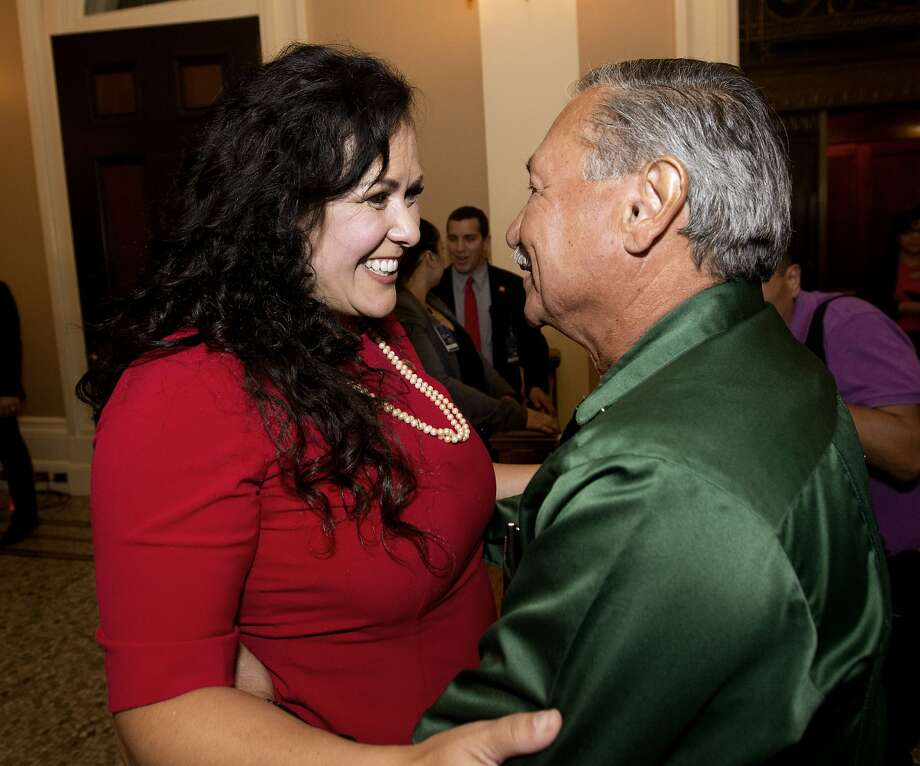 Assemblywoman Lorena Gonzalez receives congratulations last month from Arturo Rodriguez, president of the United Farm Workers, after the Assembly approved her bill requiring farmworkers be paid overtime after working eight hours. Photo: Rich Pedroncelli, Associated Press