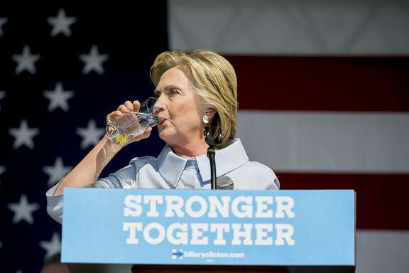 FILE-- Hillary Clinton, the Democratic presidential nominee, takes a drink of water after coughing at the 11th Congressional District Labor Day Parade and Festival in Cleveland, Sept. 5, 2016. Clinton�s campaign, responding to enormous political pressure after it belatedly said she was suffering from pneumonia, said medical records it plans to release would show �no other undisclosed condition.� (Sam Hodgson/The New York Times)