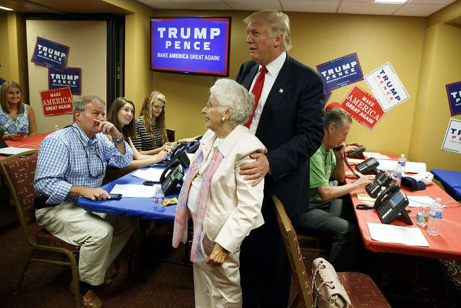 Republican presidential candidate Donald Trump visits a call center before the start of a rally, Monday, Sept. 12, 2016, in Asheville, N.C. Photo: Evan Vucci, Associated Press