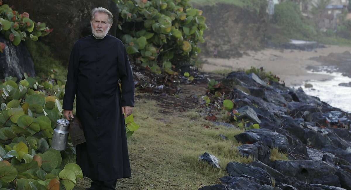 Father Douglas (Martin Sheen) tries to reinvigorate the demoralized villagers of a seaside town in