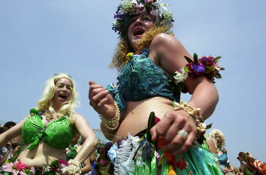 UNITED STATES - CIRCA 2002: Hawaiian-style mermaids dance down the boardwalk during the annual Mermaid Parade in Coney Island. (Photo by Linda Rosier/NY Daily News Archive via Getty Images)