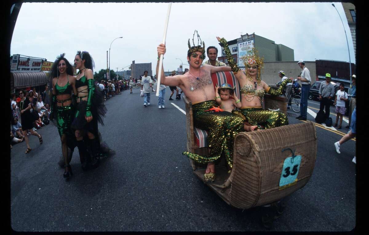 Participants ride in a float at the Mermaid Parade at Coney Island June 22, 1996 in Brooklyn, NY. The annual parade, where hundreds of participants wear costumes, celebrates the beginning of Summer and the official opening of the Atlantic Ocean. (Photo by Evan Agostini/Liaison)
