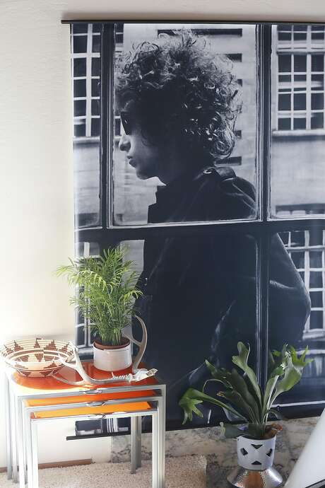 Writer Kristen Philipkoski shows her living room with poster of young Bob Dylan. Photo: Liz Hafalia, The Chronicle