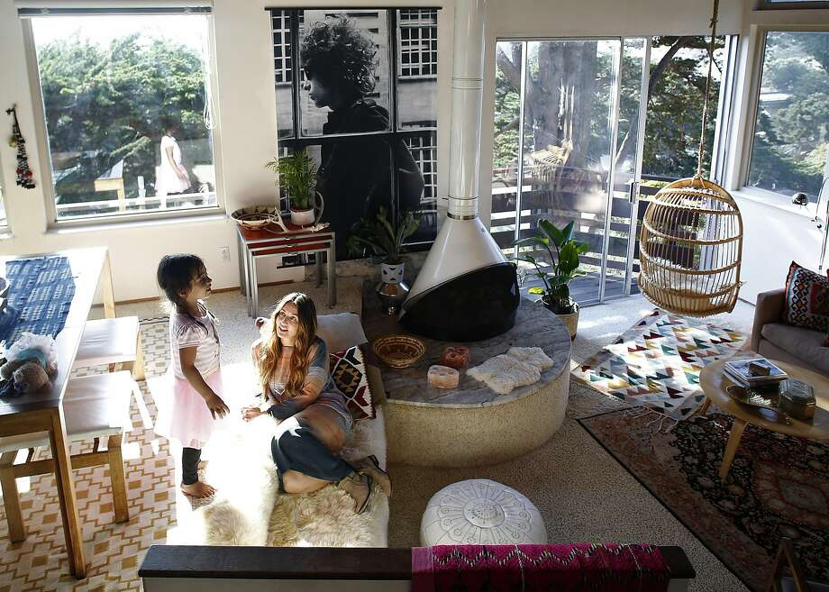 Fashion blogger Kristen Philipkoski in the living room/dining room with her daughter, Frida Karimkhany, 4, in the Pacifica home she and her husband rent. Photo: Liz Hafalia, The Chronicle