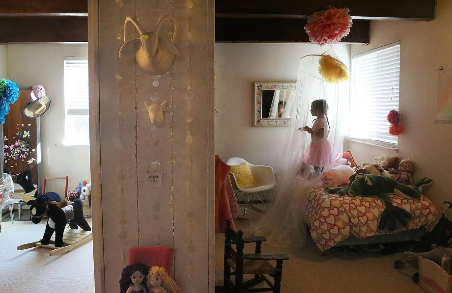 Frida Karimkhany, 4 years old, shows her room which is separated into two sides by a closet seen in the middle of the room at home on Tuesday, September 6, 2016, in Pacifica, Calif. Photo: Liz Hafalia, The Chronicle