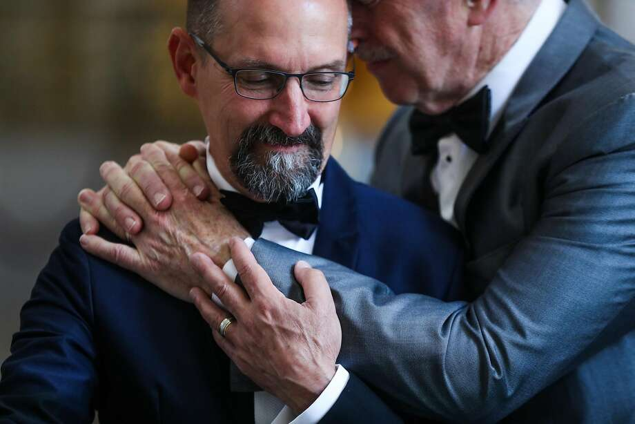 David Scronce, left, and Bill Lies share an emotional moment before getting married at San Francisco's City Hall, in May. Photo: Gabrielle Lurie, Special To The Chronicle