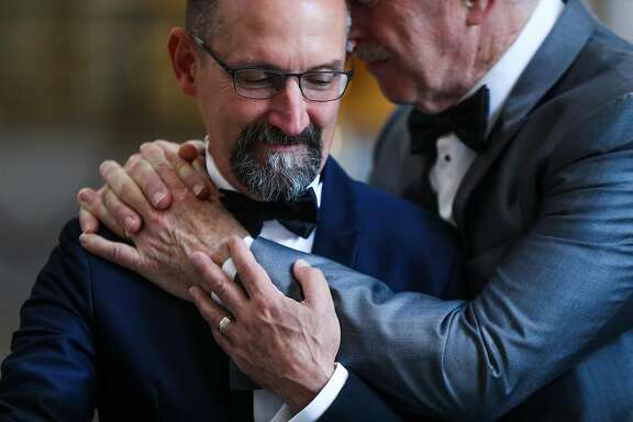 (l-r) David Scronce, 56 and Bill Lies, 64 share an emotional moment, as they stand for a portrait, before getting married, at San Francisco's City Hall, in San Francisco, California, on Friday, May 13, 2016.