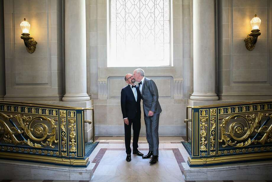 Bill Lies kisses David Scronce before they got married at San Francisco's City Hall in May. Lies said he expects a higher number of gay couples will get married time goes on. Photo: Gabrielle Lurie, Special To The Chronicle