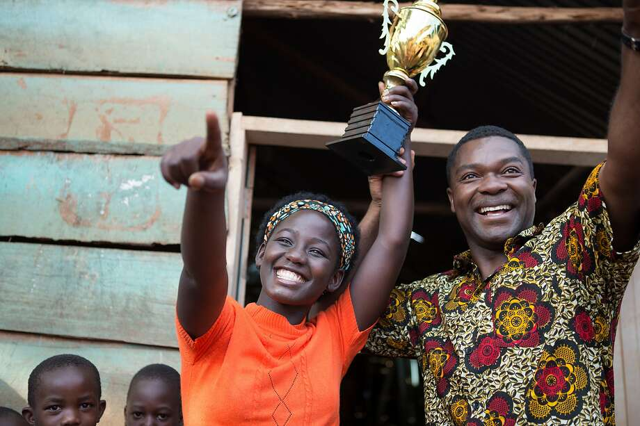 """Chess prodigy Phiona (Madina Nalwanga) celebrates a tournament victory with her mentor, Robert (David Oyelowo), in the colorful """"Queen of Katwe."""" Photo: Walt Disney Pictures"""