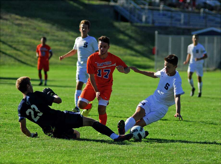 Staples goalie Ziggy Hallgarten, left, goes for the ball while Danbury's Ryan Rodrigues chases during a boys soccer game on Monday, September 12th, 2016 Photo: Ryan Lacey/Hearst Connecticut Media / Westport News Contributed