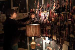 John Hinckley, Jr. (Kyle S. More) admires his shrine to Jodie Foster (San Antonio's Katia Lara) in 'Killing Reagan,' a movie coming to National Geographic Channel.