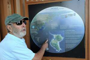Franklin Bloomer of the Calf Island Conservancy uses a trail map to speak about Calf Island during the Calf Island Conservancy and Greenwich Audubon tour of Calf Island off the coast of Greenwich, Conn., Saturday, Sept. 10, 2016. A group of about 25 people were given a guided wildlife tour of Calf Island by Audubon naturalists.