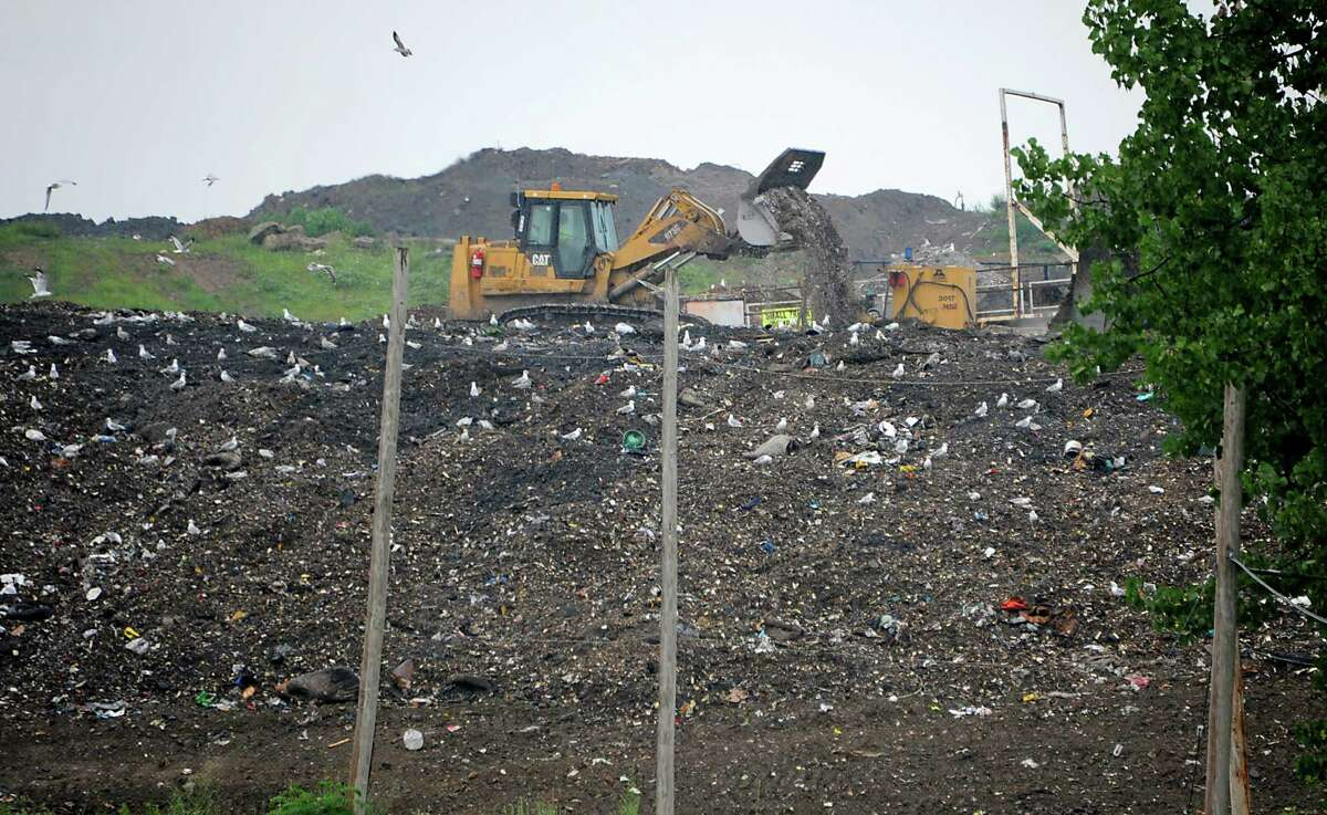 Tractors move solid waste at the Colonie Landfill on Tuesday, Aug. 5, 2014, in Colonie, N.Y. (Lori Van Buren / Times Union archive)