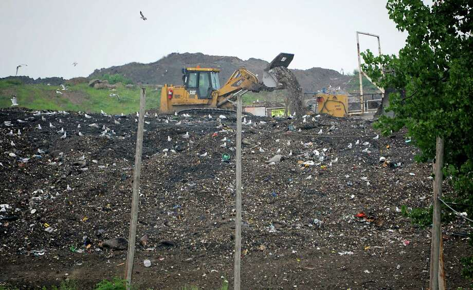 Tractors move solid waste at the Colonie Landfill on Tuesday, Aug. 5, 2014, in Colonie, N.Y.  (Lori Van Buren / Times Union archive) Photo: Lori Van Buren / 00028060A