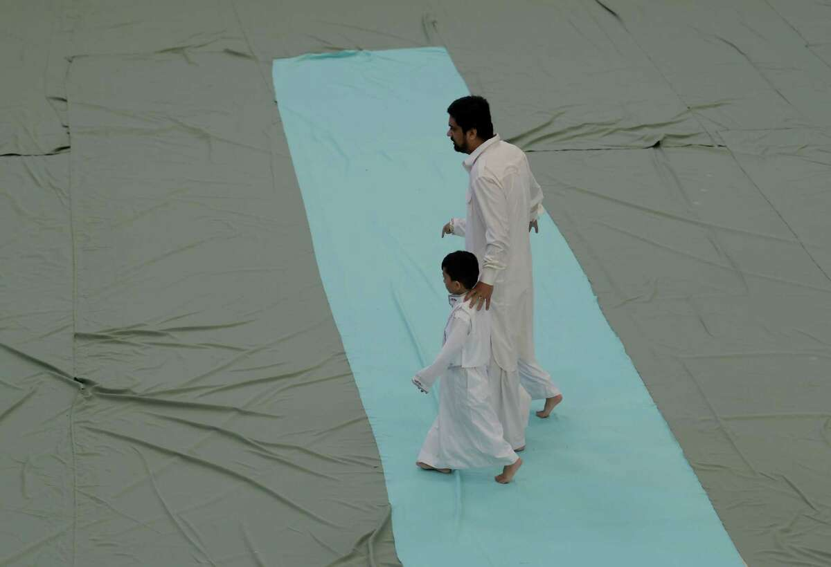 Worshippers arrive to celebrate Eidul Adha( which follows the completion of hajj, pilgrimage to holy sites in and around Mecca in Saudi Arabia) at the Islamic Center of the Captal District Monday Sept. 12, 2016 Colonie, N.Y. (Skip Dickstein/Times Union)