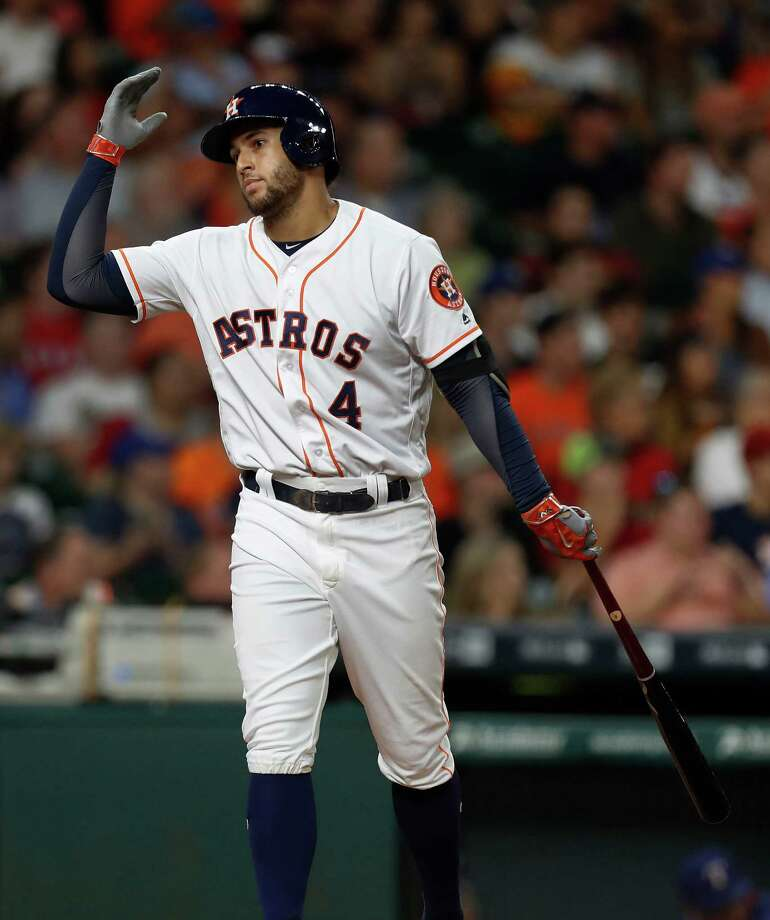 Houston Astros right fielder George Springer (4) reacts after lining out to Texas Rangers third baseman Adrian Beltre during the third inning of an MLB game at Minute Maid Park, Monday, Sept. 12, 2016 in Houston. Photo: Karen Warren, Houston Chronicle / 2016 Houston Chronicle