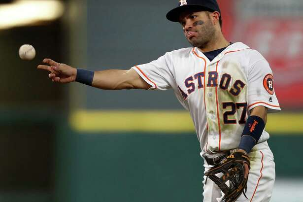 Houston Astros second baseman Jose Altuve (27) throws to first as Texas Rangers Mitch Moreland grounded out during the third inning of an MLB game at Minute Maid Park, Monday, Sept. 12, 2016 in Houston.