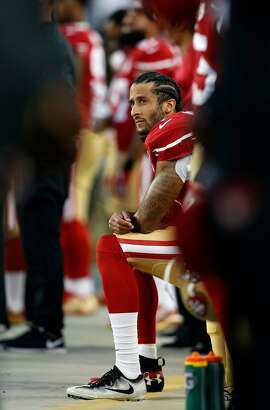 San Francisco 49ers' Colin Kaepernick kneels during National Anthem before playing Los Angeles Rams during NFL game at Levi's Stadium in Santa Clara, Calif., on Monday, September 12, 2016.