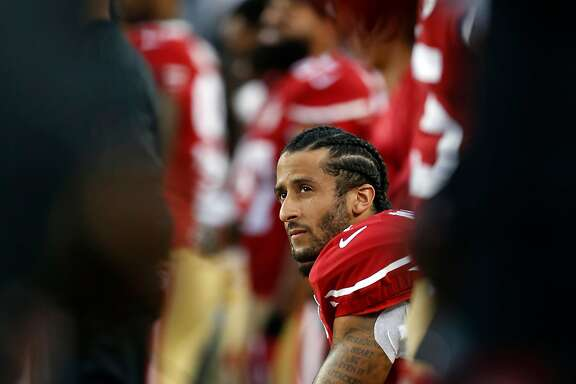 San Francisco 49ers' Colin Kaepernick kneels during National Anthem before playing Los Angeles Rams during NFL game at Levi's Stadium in Santa Clara, Calif., on Monday, September 12, 2016.