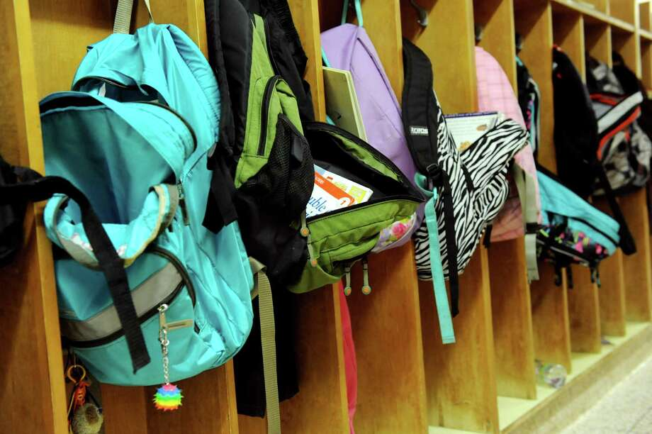 Cubbies with backpacks line the hallway on Tuesday, April 1, 2014, at Voorheesville Elementary in Voorheesville, N.Y. (Cindy Schultz / Times Union) Photo: Cindy Schultz / 00026316A