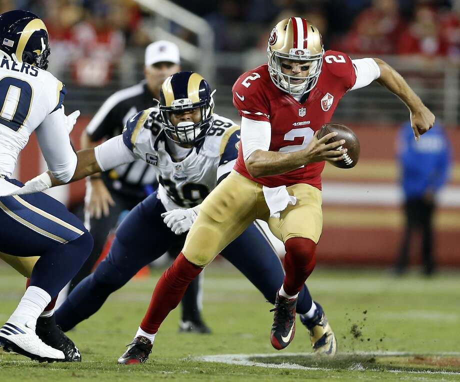 San Francisco 49ers' Blaine Gabbert scrambles away from Los Angeles Rams' Aaron Donald in 2nd quarter during NFL game at Levi's Stadium in Santa Clara, Calif., on Monday, September 12, 2016. Photo: Scott Strazzante, The Chronicle