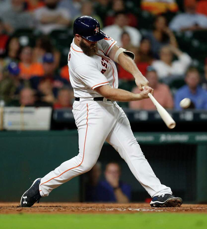 Houston Astros designated hitter Evan Gattis (11) hits a home run to tie the game during the ninth inning of an MLB game at Minute Maid Park, Monday, Sept. 12, 2016 in Houston. Photo: Karen Warren, Houston Chronicle / 2016 Houston Chronicle