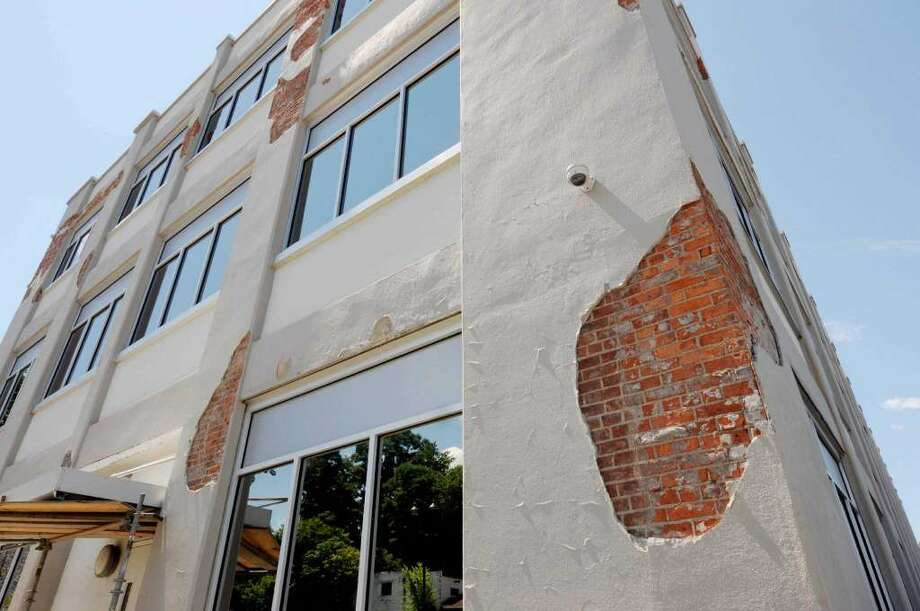 The crumbled exterior of the former Lamicoid building that Galesi Group restored for Schenectady County before it was fixed.