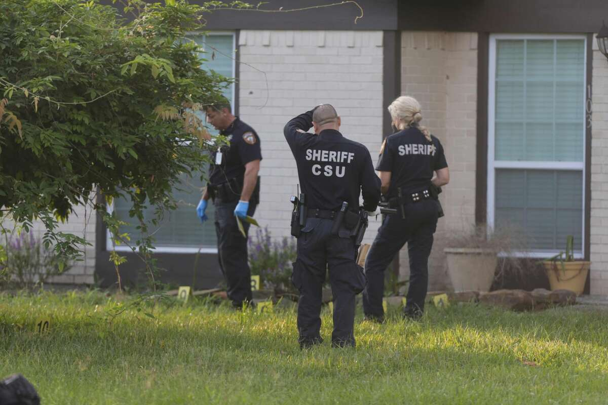 Harris County sheriff's deputies comb over a home in the 100 block of Spanish Trace Street in Crosby, Texas, on Sept. 13, 2016. Earlier that morning, a resident shot and wounded a man during an attempted home invasion.