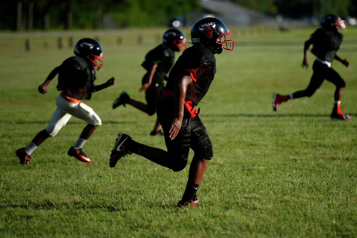 Members of the Beaumont Bulls 11 and 12-year-old football team practice on Monday evening. The team kneeled during the national anthem before their game on Saturday. Photo taken Monday 9/12/16 Ryan Pelham/The Enterprise