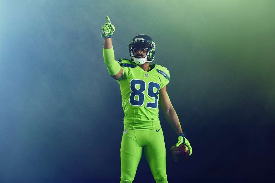 "Wide receiver Doug Baldwin models the Seahawks' ""Action Green"" uniform. The good news: The Seahawks only have to wear these once a year. Photo: Zach Ancell"