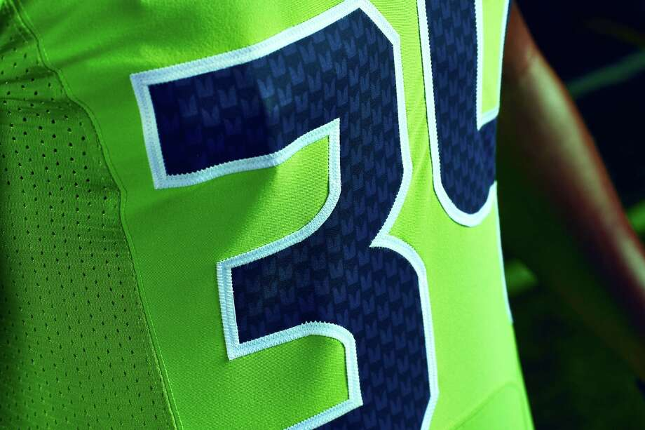 "A close-up shot of the Seahawks' ""Action Green"" uniform, part of the NFL's ""Color Rush"" series. Photo: Zach Ancell"