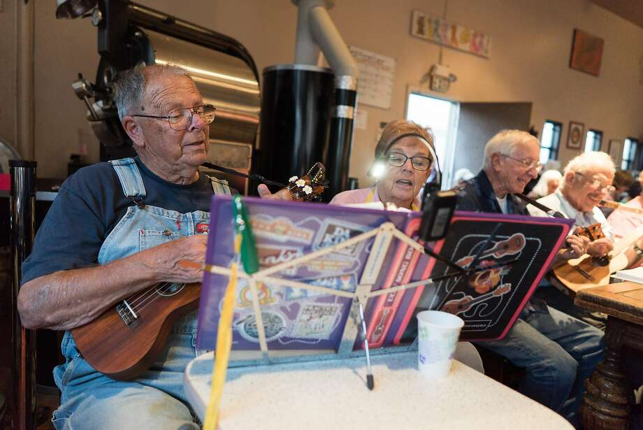 Bob and Joy Rewick, above, and Ellen Furman, right, join in the playing at Ukulele Night at Dana Street Roasting Company in Mountain View. Photo: James Tensuan, Special To The Chronicle