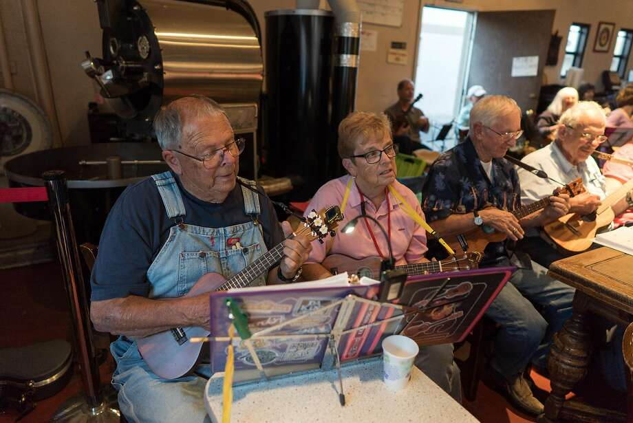 Bob and Joy Rewick play along during Ukulele Night at Dana Street Roasting Company in Mountain View, Calif. on Monday, Sept. 12, 2016. As more Baby Boomers retire the Ukulele has seen a rise in popularity. Last year, 1.2 million Ukuleles were sold. Photo: James Tensuan, Special To The Chronicle