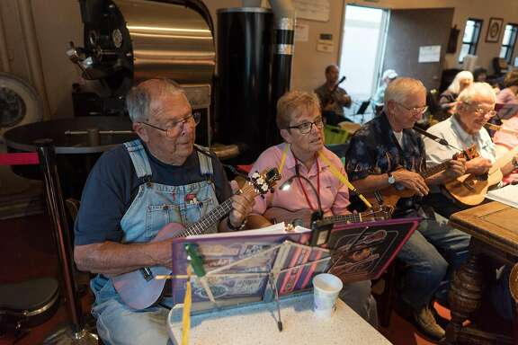 Bob and Joy Rewick play along during Ukulele Night at Dana Street Roasting Company in Mountain View, Calif. on Monday, Sept. 12, 2016. As more Baby Boomers retire the Ukulele has seen a rise in popularity. Last year, 1.2 million Ukuleles were sold.