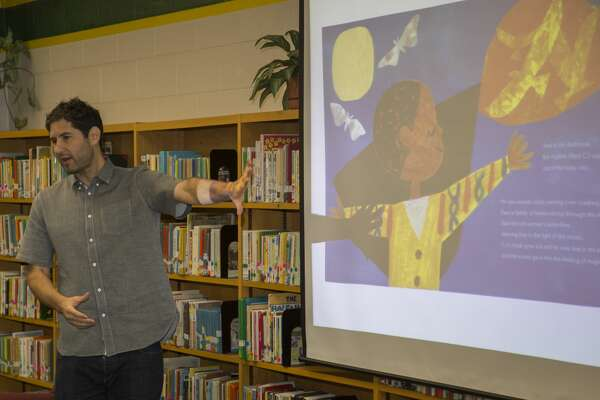 Author Matt De La Pena reads his book, Last Stop on Market Street, and talks about the story Monday 09-12-16 to Milam Elementary first graders as part of Project Literacy. Tim Fischer/Reporter-Telegram