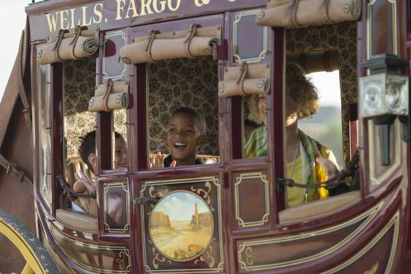 Milam Elementary students and administrators ride in the Wells Fargo stagecoach Monday 09-12-16 as they travel to Milam Elementary as part of Project Literacy.